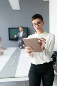 Beautiful businesswoman holding tablet in office